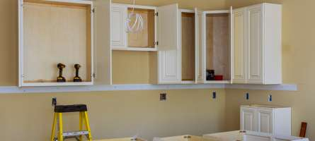 custom-kitchen-cabinets-cream-colour-in-various-stages-of-installation